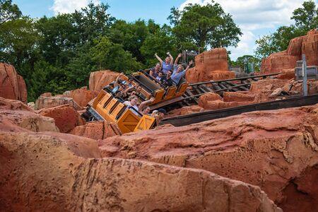 Orlando, Florida. May 10, 2019. People enjoying amazing Big Thunder Mountain Railroad on cloudy sky background in Magic Kingdom at Walt Disney World (6) Редакционное