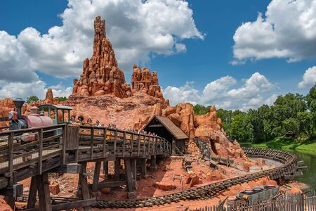 Orlando, Florida. May 10, 2019. People enjoying amazing Big Thunder Mountain Railroad on cloudy sky background in Magic Kingdom at Walt Disney World (18)