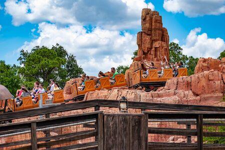 Orlando, Florida. May 10, 2019. People enjoying amazing Big Thunder Mountain Railroad on cloudy sky background in Magic Kingdom at Walt Disney World (24) Редакционное
