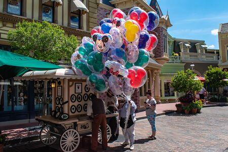 Orlando, Florida. May 10, 2019. Person selling colorful Mickey balloons in Magic Kingdom at Walt Disney World.