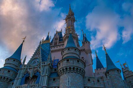 Orlando, Florida. May 10, 2019. Top view of Cinderella Castle on lightblue clody sky background in Magic Kingdom at Walt Disney World (1) Редакционное