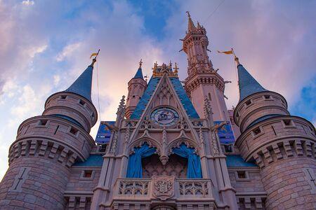 Orlando, Florida. May 10, 2019. Top view of Cinderella Castle on lightblue clody sky background in Magic Kingdom at Walt Disney World (2)