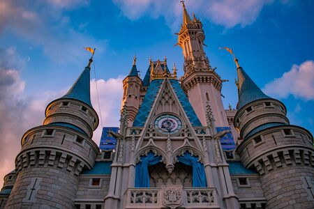 Orlando, Florida. May 10, 2019. Top view of Cinderella Castle on sunset background in Magic Kingdom