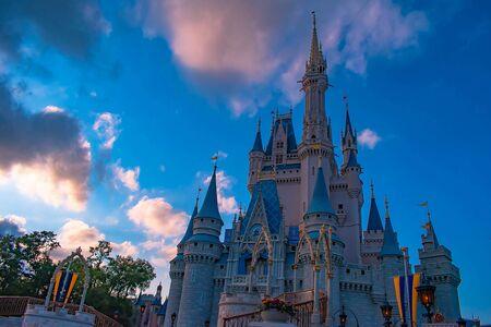 Orlando, Florida. May 10, 2019. Top view of Cinderella Castle on sunset background in Magic Kingdom at Walt Disney World. Редакционное