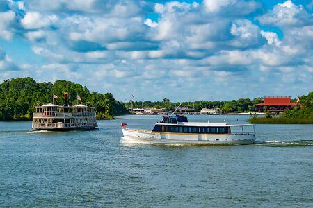 Orlando, Florida. May 10, 2019. Vintage ferry boat and taxi boat on Seven Seas Lagoon at Walt Disney World.
