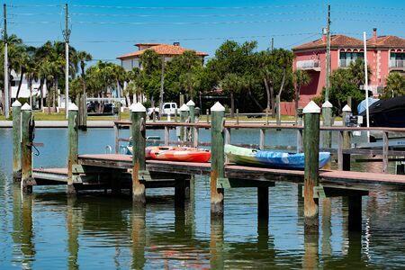 St. Pete, Florida. April 28, 2019. Colorful kayaking on small pier. Редакционное