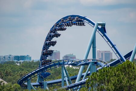 Orlando, Florida. June 05, 2019. People having fun terrific Manta Ray roller coaster at Seaworld in International Drive area (5)