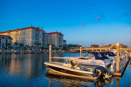 Tampa Bay, Florida. April 28, 2019 Luxury boats and Harbor Island on lightblue sky background. Editorial