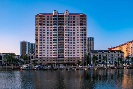 Tampa Bay, Florida. April 28, 2019 Luxury boats in Harbor Island on lightblue sky background.