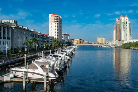 Tampa Bay, Florida. April 28, 2019. Luxury boats in Harbor Island dockside on lightblue sky background (3)