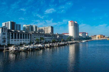 Tampa Bay, Florida. April 28, 2019. Luxury boats in Harbor Island dockside on lightblue sky background (4) Editorial