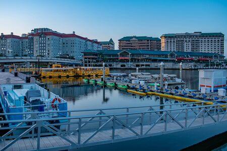 Tampa Bay, Florida. April 28, 2019. Paddleboarding, Kayaking, Taxi boats and Channelside Walk Way Plaza.