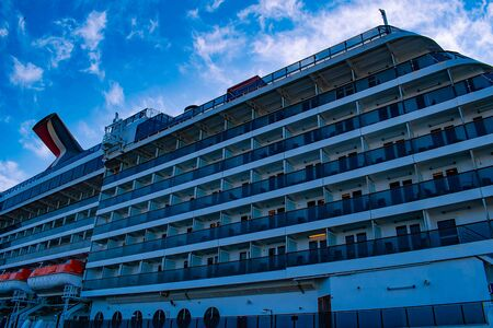 Tampa Bay, Florida. April 28, 2019. Partial view of Carnival Miracle on Cruise Terminal 3 at Port (4) Editorial