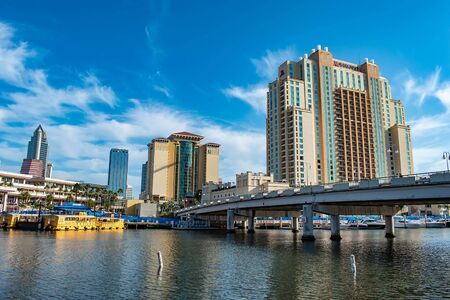 Tampa Bay, Florida. April 28, 2019. S Harbor Island Blvd bridge, Embassy Suites, Convention Center and taxi boat on Hillsborough river Editorial