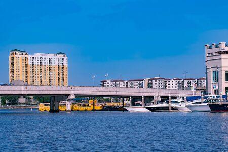 Tampa Bay, Florida. April 28, 2019. S Harbor Island Blvd bridge, luxury and taxi boats. Editorial