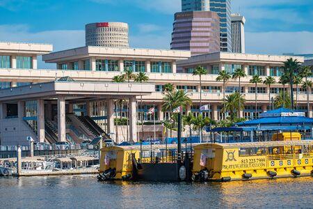 Tampa Bay, Florida. April 28, 2019. Tampa Bay Convention Center and Taxi boats.
