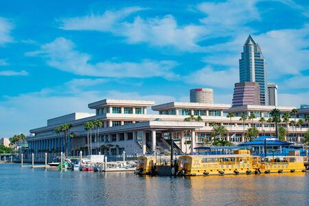 Tampa Bay, Florida. April 28, 2019. Tampa Convention Center and colorful taxi boats (1) Editorial