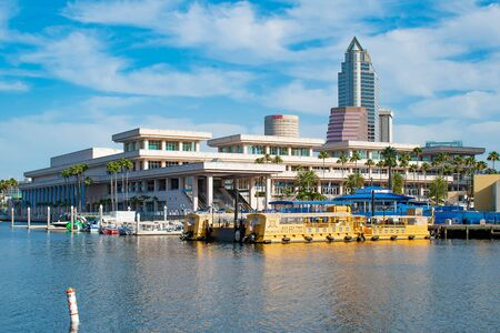 Tampa Bay, Florida. April 28, 2019. Tampa Convention Center and colorful taxi boats (2) Editorial