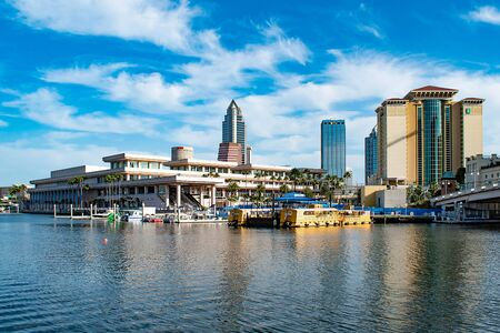 Tampa Bay, Florida. April 28, 2019. Tampa Convention Center and colorful taxi boats (3) Editorial