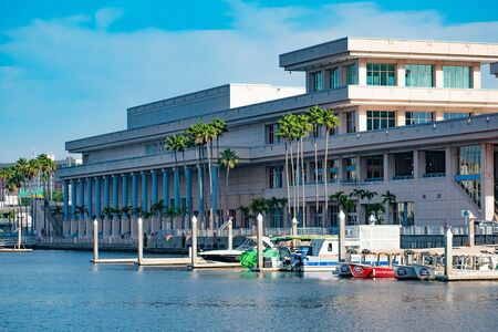 Tampa Bay, Florida. April 28, 2019. Tampa Convention Center and colorful tours boats.