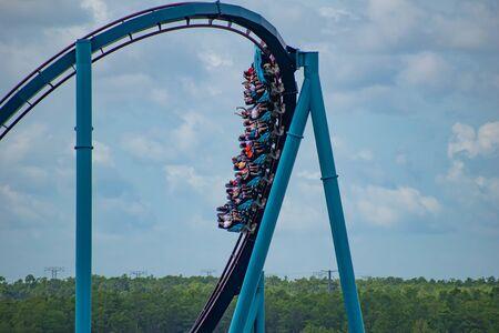 Orlando, Florida. July 01, 2019. Terrific view of people having fun Mako roller coaster at Seaworld 8 Редакционное