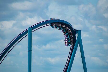 Orlando, Florida. July 01, 2019. Terrible view of people having fun Mako roller coaster at Seaworld 11