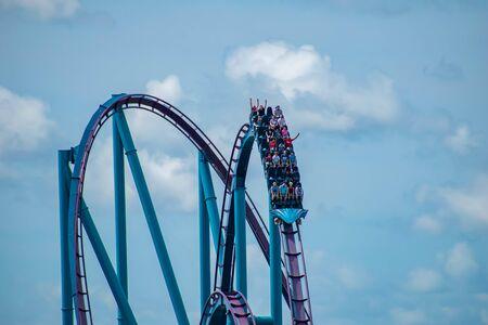 Orlando, Florida. June 30, 2019. Amazing view of people having fun Mako rollercoaster at Seaworld 2 Редакционное