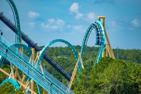 Orlando, Florida. June 30, 2019. Terrific view of people enjoying Kraken rollercoaster at Seaworld 4 Редакционное