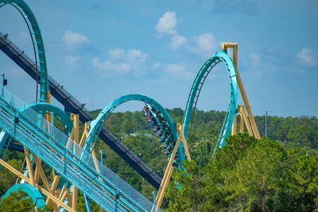 Orlando, Florida. June 30, 2019. Terrible view of people enjoying Mako roller coaster from SeaWorld 1 Редакционное