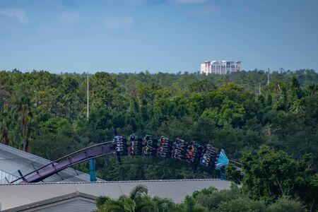 Orlando, Florida. June 30, 2019. Terrible view of people enjoying Mako roller coaster from SeaWorld 3 Редакционное