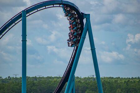 Orlando, Florida. June 30, 2019. Terrific view of people enjoying Mako rollercoaster at Seaworld 13 Редакционное