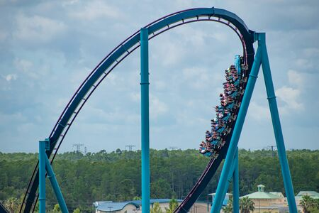 Orlando, Florida. June 30, 2019.Terrific view of people having fun Mako roller coaster at Seaworld 1