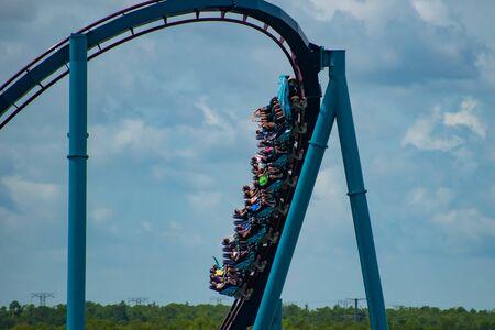 Orlando, Florida. June 30, 2019.Terrific view of people having fun Mako roller coaster at Seaworld 2