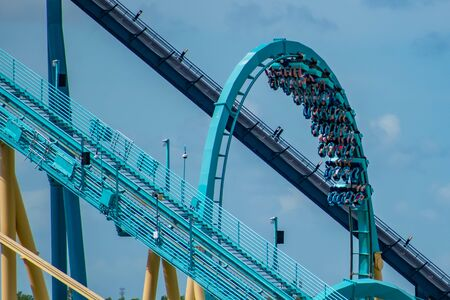 Orlando, Florida. June 30, 2019. Amazing view of people having fun Kraken rollercoaster from SeaWorld 3