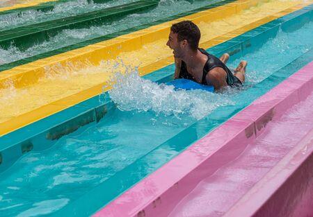 Orlando, Florida. July 01, 2019. Man enjoying amazing Tamauta Racer attraction at Aquatica 2 Редакционное