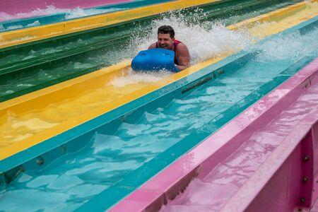 Orlando, Florida. July 01, 2019. Man enjoying amazing Tamauta Racer attraction at Aquatica 3