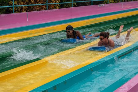 Orlando, Florida. July 01, 2019. People having fun in Taumata Racer attraction at Aquatica. It is the biggest thrill in the park 1