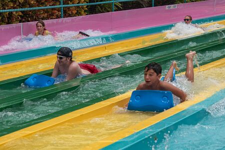 Orlando, Florida. July 01, 2019. People having fun in Taumata Racer attraction at Aquatica. Its the biggest thrill in the park 2