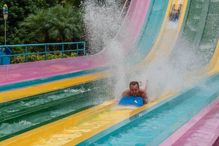 Orlando, Florida. July 01, 2019. People having fun in Taumata Racer attraction at Aquatica. It is the biggest thrill in the park 5