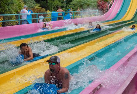 Orlando, Florida. July 01, 2019. People having fun in Taumata Racer attraction at Aquatica. It is the biggest thrill in the park 6