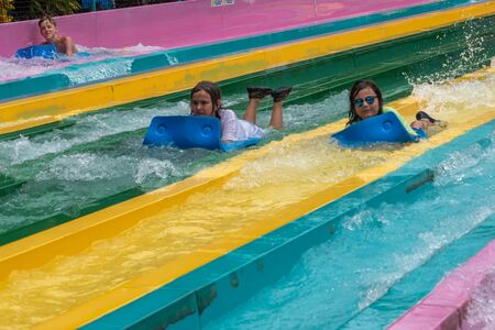 Orlando, Florida. July 01, 2019. People having fun in Taumata Racer attraction at Aquatica. It is the biggest thrill in the park 8