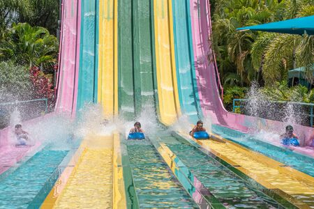 Orlando, Florida. July 01, 2019. People sliding down to staggeringly steep hill in Tamauta Racer at Aquatica 1