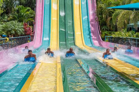 Orlando, Florida. July 01, 2019. People sliding down to staggeringly steep hill in Tamauta Racer at Aquatica 2
