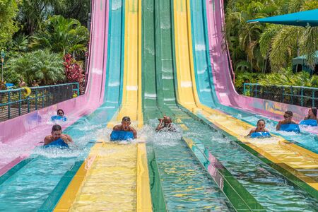 Orlando, Florida. July 01, 2019. People sliding down to staggeringly steep hill in Tamauta Racer at Aquatica 3