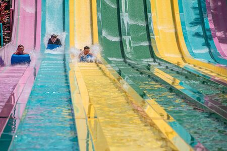 Orlando, Florida. July 01, 2019. People sliding down to staggeringly steep hill in Tamauta Racer at Aquatica 4 Редакционное