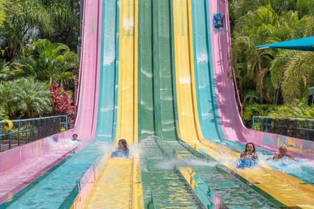 Orlando, Florida. July 01, 2019. People sliding down to staggeringly steep hill in Tamauta Racer at Aquatica 5