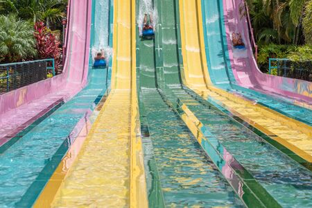 Orlando, Florida. July 01, 2019. People sliding down to staggeringly steep hill in Tamauta Racer at Aquatica 6