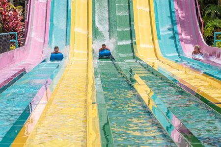 Orlando, Florida. July 01, 2019. People sliding down to staggeringly steep hill in Tamauta Racer at Aquatica 7 Редакционное
