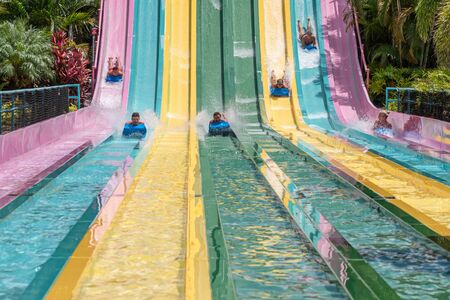 Orlando, Florida. July 01, 2019. People sliding down to staggeringly steep hill in Tamauta Racer at Aquatica 8
