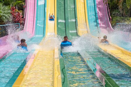 Orlando, Florida. July 01, 2019. People sliding down to staggeringly steep hill in Tamauta Racer at Aquatica 9 Редакционное